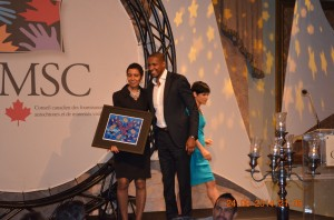 Massai Ujiri, Keynote Speaker, receiving a token of appreciation from CAMSC President, Cassandra Dorrington